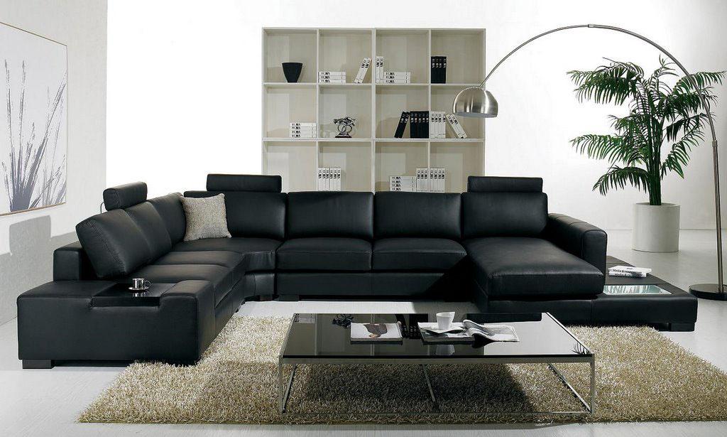 П-образный диван черного цвета в интерьере